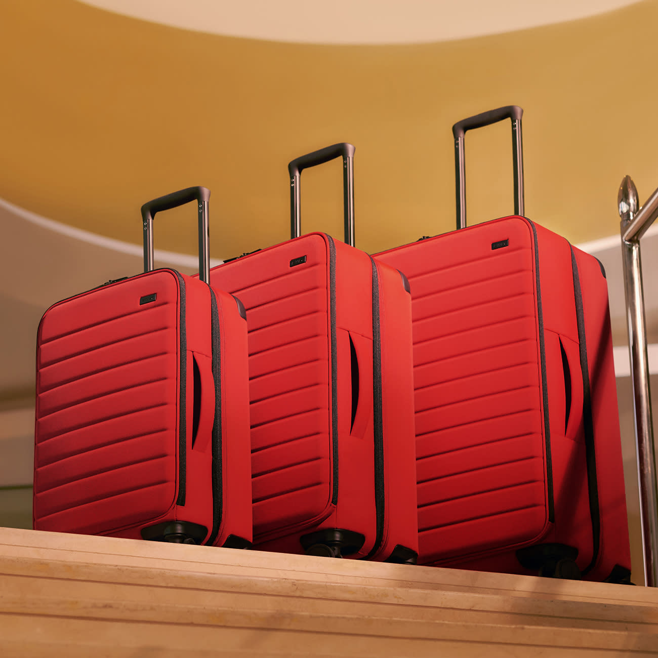 Away red soft-sided suitcases