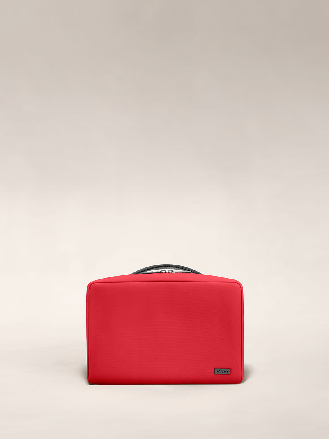 Front view of the small toiletry bag in red cherry