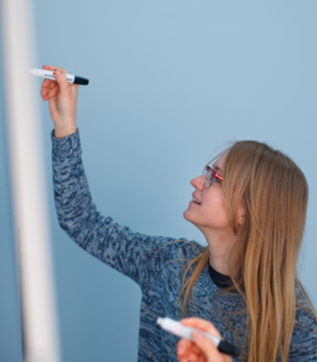 businessmodel woman writing on whiteboard