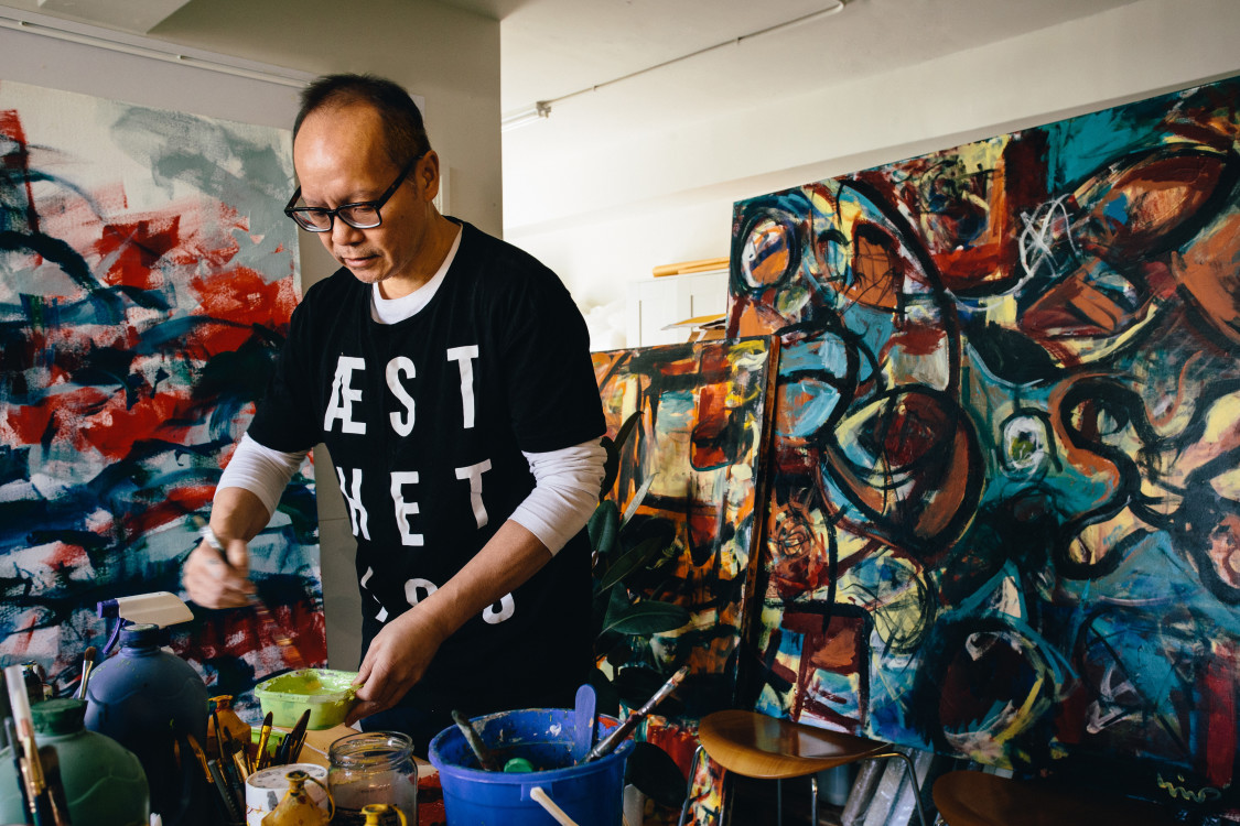 Verisart certified artist Norm Yip in his studio, courtesy of the artist.