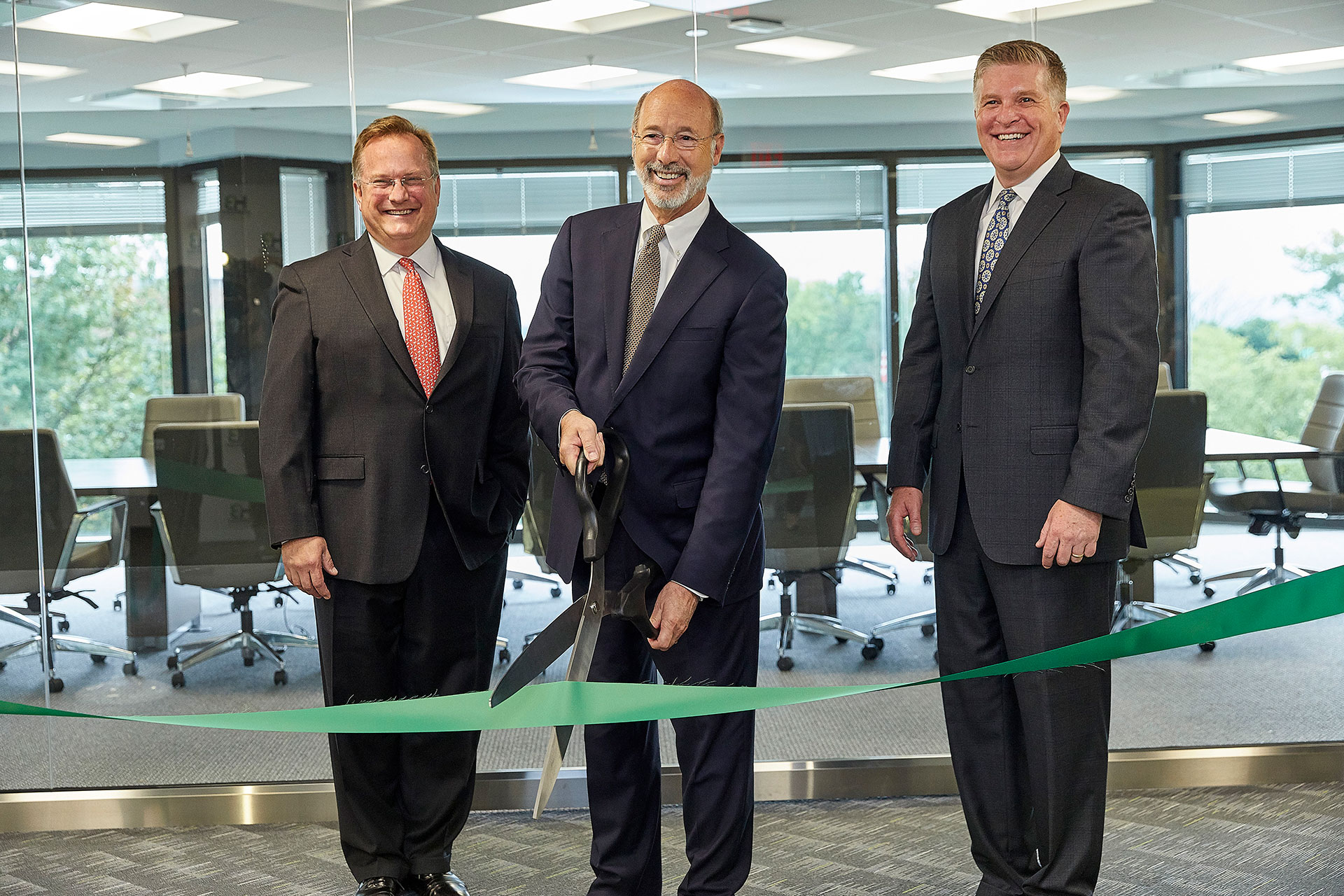 Harmony Biosciences, LLC welcomes Pennsylvania Governor Tom Wolf to cut the ribbon at the company's official opening of its new headquarters in Plymouth Meeting, Pennsylvania. Pictured here (left to right) are Chris Molineaux, President and CEO of Life Sciences PA, Governor Wolf and John C. Jacobs, President and CEO of Harmony Biosciences