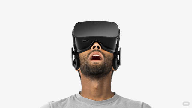 An image showing a man wearing the VR headset