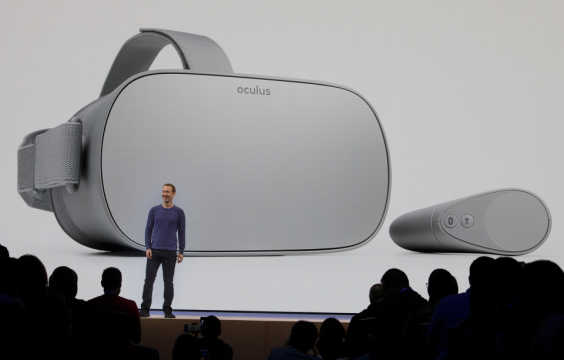 A picture showing a Facebook keynote and the Oculus Go VR headset in the background