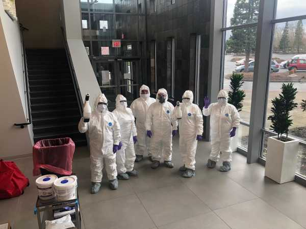 group of cleaning experts in protective equipment.