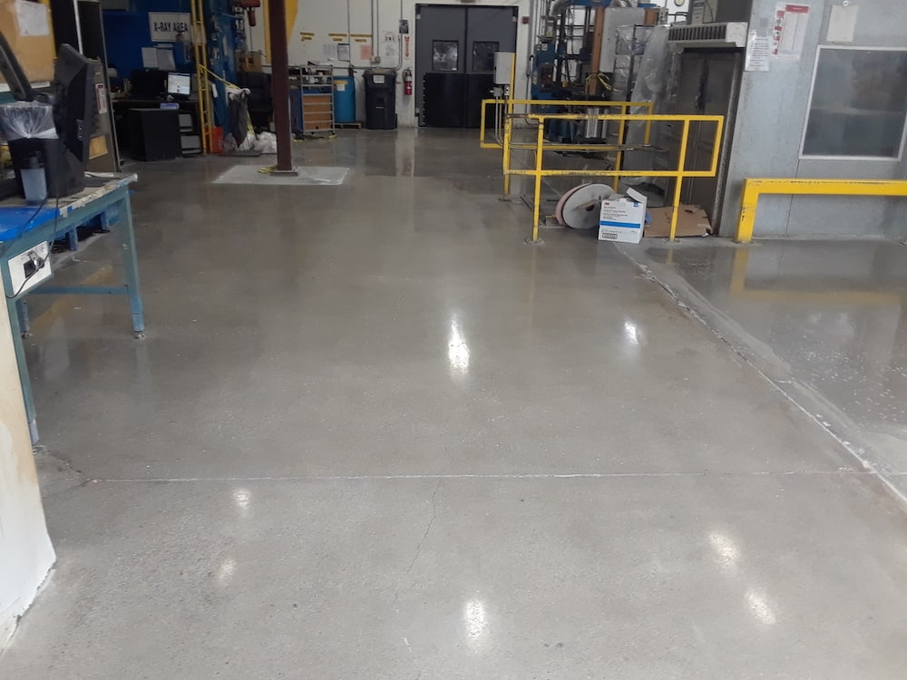lights reflecting off polished, warehouse floor.