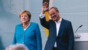 German Chancellor Angela Merkel L and Armin Laschet, leader of German Christian Democratic Union CDU