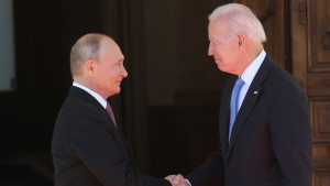 Russian President Vladimir Putin greets US President Joe Biden during the US - Russia Summit.