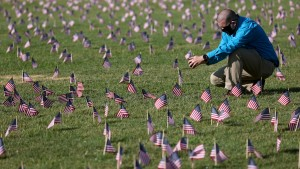 Chris Duncan, whose 75 year old mother Constance died from COVID on her birthday, photographs a COVID Memorial Project installation of 20,000 American flags on the National Mall as the United States crosses the 200,000 lives lost in the COVID-19 pandemic