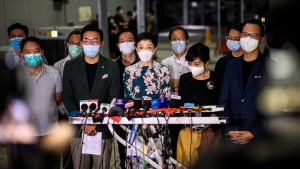 Pro-democracy lawmakers gather outside the entrance of the Hong Kong Legislative Council for a press conference.