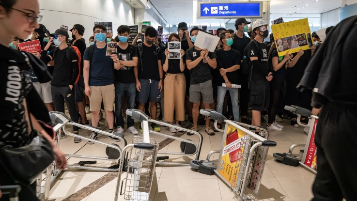 Image result for hong kong protest airport harass