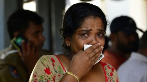 Woman mourning after the Sri Lanka attacks
