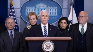 Members of the coronavirus task force in the White House press briefing room in March 2020.