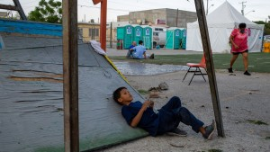 Migrant children play in the courtyard of the shelter of Ciudad Juarez Chihuahua, Mexico, on April 26, 2021.