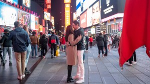 A couple kisses in Times Square on Memorial Day weekend on May 29, 2021 in New York City. On May 19, 2021.