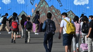 Students walk to their classrooms at a public middle school in Los Angeles, California,
