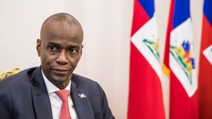 President Jovenel Moise sits at the Presidential Palace