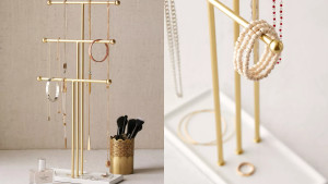 gold jewelry stand with three tiers for hanging necklaces