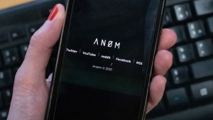 An illustration picture shows the ANoM logo displayed on the screen of an smartphone on june 8, 2021 in Paris.