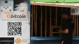 A man buys in a store that accepts bitcoins in El zonte.
