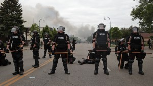 Police officers block a road on the fourth day of protests on May 29, 2020 in Minneapolis, Minnesota.