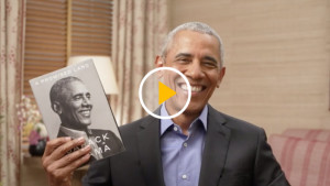 Obama Holding Book With Play Button