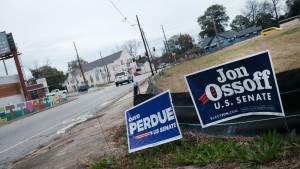 Signs for senate candidates David Perdue (R-GA) and Sen. Kelly Loeffler (R-GA) stand in a yard on December 06, 2020 in Columbus, Georgia.