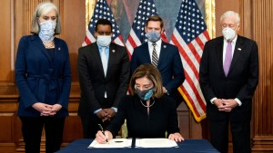 Speaker of the House Nancy Pelosi (D-CA) signs an article of impeachment against President Donald Trump at the U.S. Capitol on January 13, 2021.