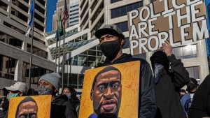Demonstrators protest outside the Hennepin County Government Center before jury selection begins at the trial of former Minneapolis Police officer Derek Chauvin on March 8, 2021 in Minneapolis, Minnesota.