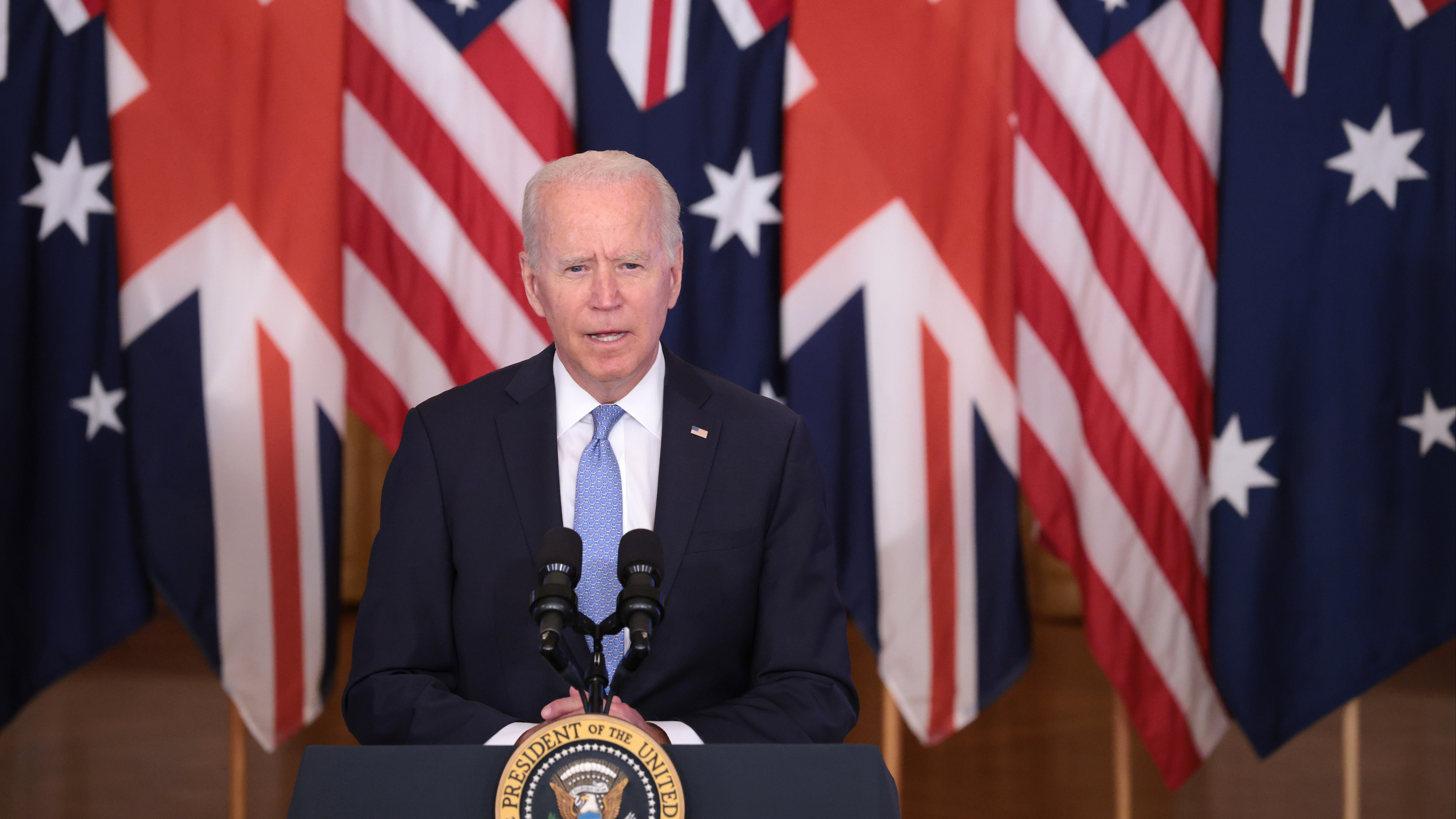 President Joe Biden speaks during an event in the East Room of the White House