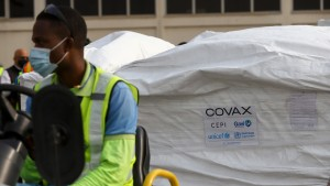 This photograph taken on February 24, 2021 shows a Covax tag on a shipment of Covid-19 vaccines from the Covax global Covid-19 vaccination programme, at the Kotoka International Airport in Accra.