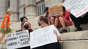 People gather for a reproductive rights rally at Brooklyn Borough Hall