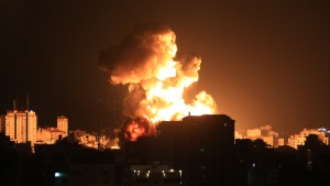 Smoke and flames rise after Israeli fighter jets conducted airstrikes in Gaza City, Gaza on May 13, 2021.