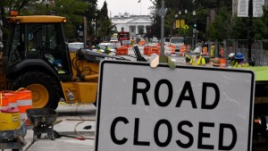 Construction workers repair a street near the White House