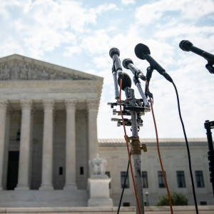 A set of microphones stand outside of the U.S. Supreme Court