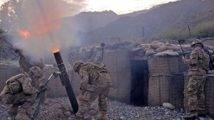 US army soldiers from Bravo company 2nd Batallion 27th Infantry Regiment fire 120 mm mortar rounds towards insurgent positions at Outpost Monti in Kunar province, on September 17, 2011.