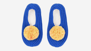 cobalt blue slippers with yellow pom poms on the them