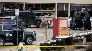 Smashed windows are left at the scene after a gunman opened fire at a King Sooper's grocery store on March 22, 2021 in Boulder, Colorado