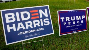 Joe Biden and President Trump's campaign signs sit side by side at a polling location in Florida.