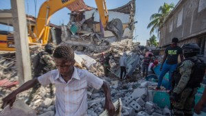 Haitians begin the work of recovering what materials can be after a 7.2-magnitude earthquake struck Haiti on August 15, 2021 in Les Cayes, Haiti.