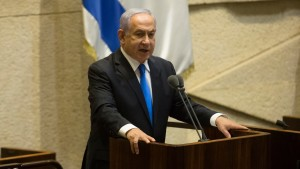 Israeli Prime Minister Benjamin Netanyahu speaks before parliament votes to approve the new government.