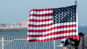 An American flag waves on the pier at Coney Island.