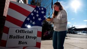 A voter drops of her ballot Colorado on November 3, 2020.