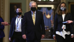 Mitch McConnell walking with a mask