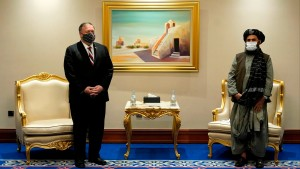 US Secretary of State Mike Pompeo (L) meets with Taliban co-founder Mullah Abdul Ghani Baradar in the Qatari capital Doha on November 21, 2020, amid signs of progress in their talks as Washington speeds up its withdrawal.