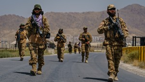 Taliban fighters secure the outer perimeter, alongside the American controlled side of of the Hamid Karzai International Airport in Kabul, Afghanistan, Sunday, Aug. 29, 2021.