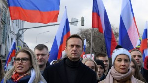 Russian opposition leader Alexei Navalny and other demonstrators take part in a march