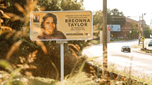 A billboard featuring a picture of Breonna Taylor and calling for the arrest of police officers involved in her death