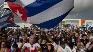 Protesters gather in front of the Versailles restaurant in the Little Havana neighborhood to show their support for the people in Cuba that have taken to the streets to protest.