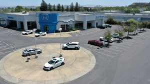 In an aerial view, the sales lot at Marin Honda is nearly empty