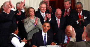 President Obama signs the Affordable Care Act into law